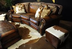 Rustic cabin decor - Beautiful hand-tooled leather and cowhide decor! #westernfurniture