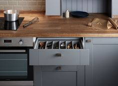 Stylish yet practical detail right down to the cutlery tray in the drawers. Fairford Slate Grey Kitchen part of the Shaker Collection by Howdens Joinery.