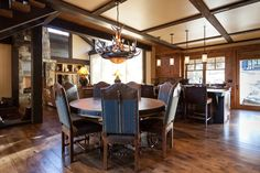 Austin Cabin by High Camp Home  leather at top of dining room chairs