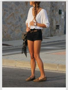 Simple look Oversized white tee with black shorts & brown belt.