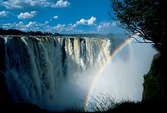 Zimbabwe, Victoria Falls..I couldn't think of a better way to get soaked from head to toe.  There are always rainbows there...for real.