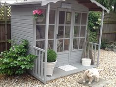 Summerhouse and a gorgeous little Westie!  Wouldn't thisne a great sewing studio?
