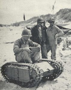 "u.s. soldiers with captured ""goliath"" remote tracked vehicle"