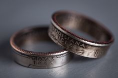 "State Quarter Rings by Coin Rings via Bourbon and Boots I would not choose either state pictured, but these are some pretty darn awesome rings!  Available in any state, sizes from 4.5 (my ring finger!) to 14; widths of 1/4"" or 1/2"". Love them."