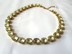 Matte Citrine Collet Necklace. https://www.etsy.com/listing/190708801/citrine-anna-wintour-necklace-yellow
