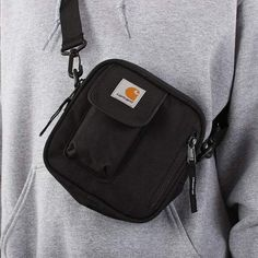 Free UK hipping on orders over Buy the Carhartt WIP Essentials Bag in Black. Made from durable polyester 'duck' canvas, adjustable strap shoulder bag. Latest Shoes, New Shoes, Carhartt Wip, Shirt Jacket, Essentials, Pouch, Urban, Shoulder Bag, Bags