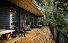 Image 9 of 37 from gallery of House on Todos Los Santos Lake / Apio Arquitectos. Photograph by Alejandra Valenzuela Exterior Colors, Interior And Exterior, Haus Am See, Casas Containers, Wooden House, Cabins In The Woods, Whistler, Log Homes, Black House