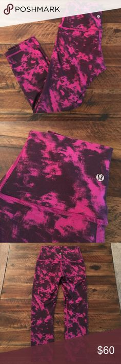 Wunder under crops Lululemon high waisted wunder under crops. Gorgeous pink and berry print. EUC. No sizing info/tags, no pocket. lululemon athletica Pants Leggings