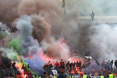 Fans of Frankfurt throw smokebombs during the Bundesliga match against Karlsruher SC at Wildpark stadium.