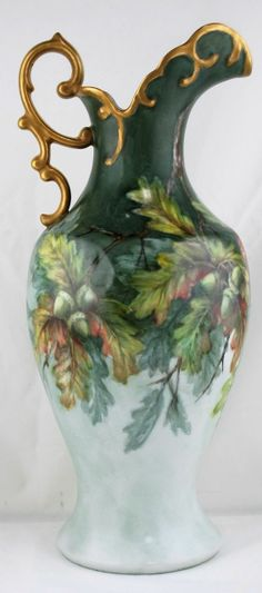 Exquisite Hand Painted one-of-kind Porcelain Pitcher by Margaret Surber. On a background of mottled pale green she has painted a fall scene with acorns and autumn colored leaves, dated 1999