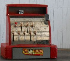 We had a red Tom Thumb cash register toy when I was a kid.  (I think it may have belonged to my mother when she was a child.)