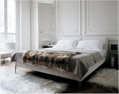 Traditional moulding, tall ceilings, contemporary furniture. Must recreate this look with a client at some point!