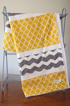 Cozy and lightweight quilt for you little one! Lightweight quilt  100% cotton prints on the front with white dimple dot minky on the back.