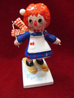 Porcelain Raggedy Ann on Skis Christmas Ornament ...at Tons of Treasures in Laguna Niguel
