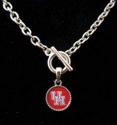 New, Pewter Houston graphics logo pendant, Silver Toggle Necklace. Toggle closure, link necklace is lead-free, Sterling Silver plated, and laquer finished. Pendant has a graphics-based charm that is cast using a lead-free, solid pewter base which is tumbled and polished to give it a beautiful sheen, and finished with a high quality, detailed and colorful, laminated vinyl decal on one side. | eBay!