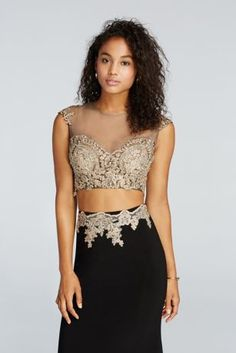 More than just a Prom dress, this uniquely beaded crop top ensemble has the details that'll keep you in the spotlight all night long!  Trendy illusion cap sleeve crop top is beautifully embellished with iridescent, metallic beading for sparkle that'll set you above the rest.  Sleek, floor length fitted jersey skirt features matching beaded decoration at the waist to complete this eye-catching Prom look.  Designed by Sean Collections.  Fully lined. Imported. Zipper Back.  Dry clean only. Do