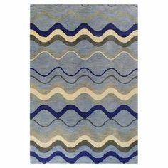 Hand-tufted wool rug with a waves motif.    Product: RugConstruction Material: 100% WoolColor: BlueNote: Please be aware that actual colors may vary from those shown on your screen. Accent rugs may also not show the entire pattern that the corresponding area rugs have.Cleaning and Care: Regular vacuuming and spot cleaning recommended