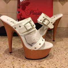 Nwt pleaser white heels leather 6 studs buckle Nwt pleaser, white and faux wood like heels. leather size 6 with studs and a buckle. Super cute can wear anywhere. 5.5 inch heel and about 2in front. Will be sending without the box because of shipping but I'll send the pleaser shoe bag Pleaser Shoes Heels Bedroom Heels, White Heels, 5 Inch Heels, Cream White, Studs, Peep Toe, Super Cute, Shoes Heels, Shoe Bag