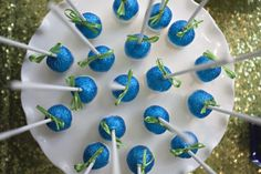 blue glittered cake pops by Sweet Lauren Cakes   Peacock blue and green baby shower by Amy Nichols Special Events