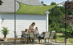 Small patio ideas the home depot shade a family gathered around dining set covered by sun sail with pavers Concrete Patios, Outdoor Living Areas, Outdoor Spaces, Outdoor Decor, Back Porch Makeover, Pallet Furniture Easy, Building A Patio, Decks And Porches, Small Patio