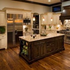 Traditional kitchen by Oakley Home Builders; love the antique cream cabinets with the contrasting island.