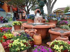 Mickey pouring a vase into the fountain at Downtown Disney, Kissimee, Florida.