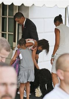 apsies: President Barack Obama, Malia Obama, Sasha Obama, and first lady Michelle Obama are greeted by the family dog, Bo, as they arrive at the White House on Aug. 17, 2009. (via)