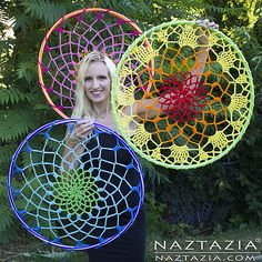 I've been doing a lot of community yarn bombing lately, and these mandalas - or - dream catchers - work great for that purpose. They also look really pretty indoors too.