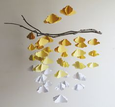 Dimensional clouds made from heavy cardstock paper and are strung from a branch and finished of with a crystal bead.  Standard branch is 20