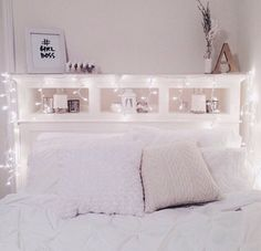 Pretty girl bedroom inspiration with lights on the bed