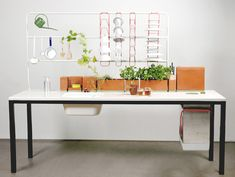 sink to wash dishes, hang dishes to dry and let them drip and water your herbs and compost at the end of the table!