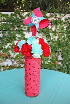Carnival party table centerpieces made from tickets and pinwheels. This is a cute idea.