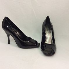 Patent leather open toe BCBG stilettos. In excellent condition. Heel is 4 inch. 2 very minor scratches are shown in pictures 3 & 4. Please see pictures carefully and ask questions. Thanks BCBG Shoes Heels