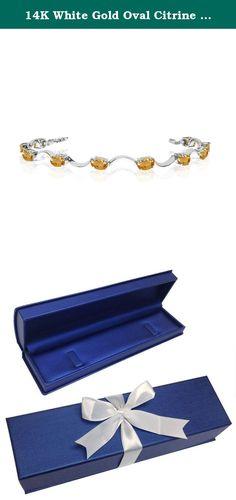 14K White Gold Oval Citrine Curved Bar Bracelet (8 Inch Length). This 14k white gold oval citrine curved bar bracelet features twelve 6x4 mm stunning natural citrine stones with a 5.40 ct total gem weight.