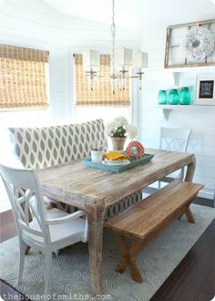 Cottage style dining space. Love the use of a bench + side chairs + settee