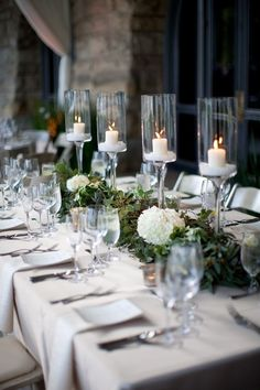 Pretty modern Christmas tablescape with white hydrangeas, tall white candles and winter greenery \\ 50 Stunning Christmas Tablescapes - Christmas Decorating - Style Estate Christmas Table Settings, Christmas Tablescapes, Christmas Table Decorations, Holiday Tables, Holiday Decor, Holiday Dinner, Candle Decorations, Thanksgiving Holiday, Seasonal Decor