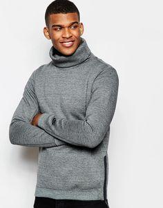 Sweatshirt von Nike weicher, verstärkter Sweatshirtstoff Rollkragen bestickte Ärmel anliegende Bündchen Seitenreißverschlüsse reguläre Passform - entspricht den Größenangaben Maschinenwäsche 66% Baumwolle, 34% Polyester Model trägt Größe M und ist 188 cm/6 Fuß 2 Zoll groß Nike Style-Code: 679908-037