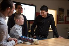 college student Albert Manero, right, looks on as Alex Pring displays his bionic arm that Manero and Limbitless Solutions built.  and here is a video of Alex receiving his arm.  http://techcrunch.com/2015/03/12/watch-tony-stark-deliver-a-real-bionic-arm-to-a-happy-fan/