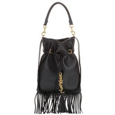 Saint Laurent - Leather shoulder bag - Embrace Saint Laurent's bohemian spirit with this leather bag. The sleek shape plays off gold-tone accents, thin fringing and a drawstring top that renders a certain slouch. Switch up your carrying options between the top handle and long shoulder strap for two entirely different looks. seen @ www.mytheresa.com
