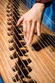 Gayageum: A traditional 12-stringed Korean instrument. I love the sound of this instrument, it is entirely gorgeous.