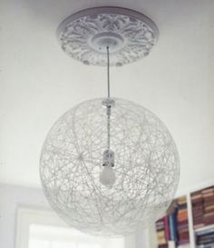 modern lamp with classic ceiling medallion