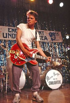 "Michael J Fox as Marty McFly rocking out to ""Johnny B. Goode"", Back To The Future Michael J Fox, Michael Fox Actor, 80s Movies, Great Movies, Movie Tv, Movie Scene, 1980s Films, 80s Movie Posters, Indie Movies"
