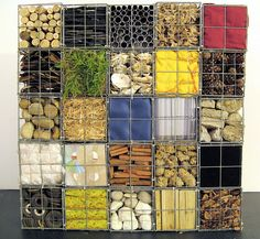 Gabion cages with various fill materials by Natasha Carsberg. not all things you would put out side in a real fence, but it gets your brain going