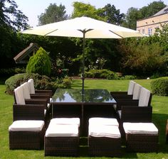 Rattan 6 Piece #Garden #Dining set includes six seats, four stools and a table with a Square structure with tempered glass on top. Back cushions and matching stool with cushion which makes it looks simply superb. It is manufactured from brown poly-rattan and brown cushions over it.