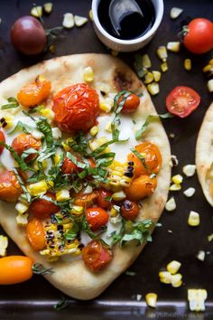 An easy delicious Charred Corn Caprese Flatbread topped with sweet Balsamic Reduction - it screams summer, takes 30 minutes to make, and uses less than 10 ingredients! You're gonna love it!