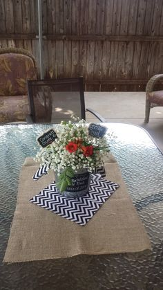 Graduation party centerpieces Chalkboard galvanized buckets from Walmart $2.47, burlap and chevron fabric, baby's breath, chalkboard picks from hobby lobby, and flowers cut from my backyard. Personal, simple, easy to do and cute
