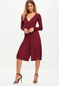 a84ee55669d A burgundy jumpsuit with long sleeves