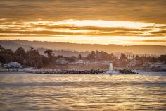 Greg - AdventuresofaGoodMan.com posted a photo:  Walton Lighthouse  Santa Cruz, California  When the dog wakes the family up at 4:45am, the only logical choice is to go to the Santa Cruz Wharf for a sunrise. ☀️🌅🌄  ------------------------------------------------------  Let's Travel the World!  I've dedicated my life to exploring our world ... and documenting the journey in photos and stories. For all the latest updates, follow along on:  FACEBOOK \ TWITTER \ INSTAGRAM \ 500PX \ MY BLOG
