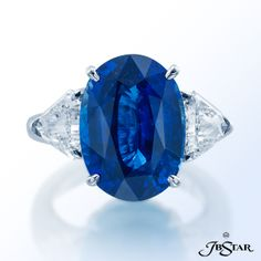 JB Star Sapphire and diamond ring featuring a breathtaking 11.29 ct oval blue sapphire from Ceylon, embraced by kite diamonds. Platinum