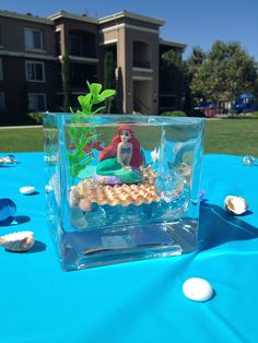 Little Mermaid Centerpiece. Jessica this would be cute cause you can still put the fishies in there!